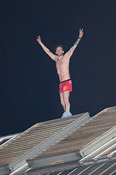 © Licensed to London News Pictures . 13/09/2015. Manchester, UK. An inmate at HMP Manchester ( Strangeways Prison ) , named as STUART HORNER , climbs on to the roof and protests conditions inside . Photo credit : Joel Goodman/LNP