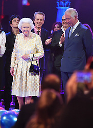 Queen Elizabeth II and the Prince of Wales with performers on stage at the Royal Albert Hall in London during a star-studded concert to celebrate the Queen's 92nd birthday.
