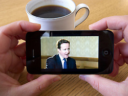 Watching video news via Youtube on an Apple iphone 4G smart phone