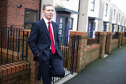 © Licensed to London News Pictures . 04/02/2014 . Sale , UK . CHRIS BRYANT waits whilst Rachel Reeves is interviewed for TV . Rachel Reeves , MP for Leeds West and Shadow Secretary of State for Work and Pensions and Chris Bryant , MP for Rhondda and Shadow Minister for Welfare Reform , join Labour candidate Mike Kane on the campaign trail ahead of the Wythenshawe and Sale East by-election , following the death of MP Paul Goggins . They visit the home of Tony Gunning (51) who suffers from hereditary adult polycystic kidney disease and is on dialysis , who says he is affected by the bedroom tax . Photo credit : Joel Goodman/LNP
