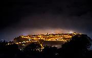 Night fog rolls in over historic Orvieto, Italy