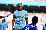 Vincent Kompany of Man city in action.Barclays premier league match, Manchester city v Chelsea at the Etihad stadium in Manchester,Lancs on Sunday 21st Sept 2014<br /> pic by Andrew Orchard, Andrew Orchard sports photography.