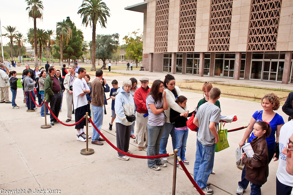 Feb. 20, 2010 -- PHOENIX, AZ:  People stand in line at the historic former Arizona State Capitol to view one of the original copies of the Declaration of Independence. Only 26 copies of the original Declaration of Independence are known to exist today after 200 were printed by John Dunlap, a colonial era printer, who was ordered to print the Declaration by the Continental Congress in 1776. Most of them are housed at universities, public libraries, city halls or other government institutions. The copy brought to Phoenix, the 25th of the 200, was found in 1989, tucked behind a painting bought at a flea market for $4, according to the Pearson Foundation, a non-profit organization that supports education efforts. It is owned by film and TV producer Norman Lear and a friend. They are making the declaration available for public viewing through the Declare Yourself Foundation, which focuses on registering people ages 18 to 29 to vote and getting them involved in local and national elections.      Photo by Jack Kurtz