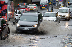 © Licensed to London News Pictures 18/06/2021. Aylesford, UK. Motorists driving through flood water on the A20 in Aylesford near Maidstone in Kent. Torrential rain is causing roads to flood in Kent as thunderstorms are set to hit the UK again today. Photo credit:Grant Falvey/LNP