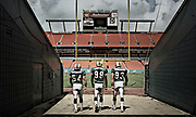 Zach Thomas, Jason Taylor and Trace Armstrong of the Miami Dolphins during a shoot for The Miami Project.