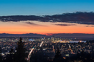 View of the City of Vancouver from Burnaby Mountain after sunset. Mount Arrowsmith is on the left (above BC Place), then downtown Vancouver, and the west end with English Bay's ships beyond. Photographed from Burnaby Mountain Conservation Area in Burnaby, British Columbia, Canada.