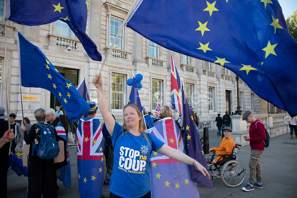 Anti-Brexit protesters wave European Union flags outside the Cabinet Office in Westminster on 17th September 2019 in London, England, United Kingdom.