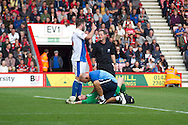 Blackburn Rovers goalkeeper, Jake Kean, receives medical treatment whilst Grant Hanley of Blackburn Rovers explains the situation to the referee during the Skybet Championship match , AFC Bournemouth v Blackburn Rovers at The Goldsands Stadium in Bournemouth, England on Saturday 28th September 2013. Picture by Sophie Elbourn/Andrew Orchard Sports Photography.
