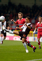 Photo: Leigh Quinnell.<br /> Swindon Town v Grimsby Town. Coca Cola League 2. 14/10/2006. Grimsbys Peter Bore gets the ball away from Swindons Andy Monkhouse.