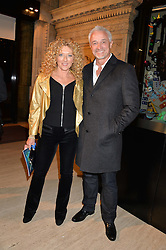 KELLY HOPPEN and JOHN GARDINER at the opening night of Cirque du Soleil's award-winning production of Quidam at the Royal Albert Hall, London on 7th January 2014.