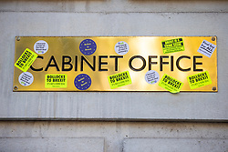 © Licensed to London News Pictures. 20/10/2018. London, UK. Anti-Brexit stickers are attached to the sign outside the Cabinet Office as protesters join the People's Vote March in central London to call on government to give the public a vote on the final Brexit deal. Photo credit: Rob Pinney/LNP