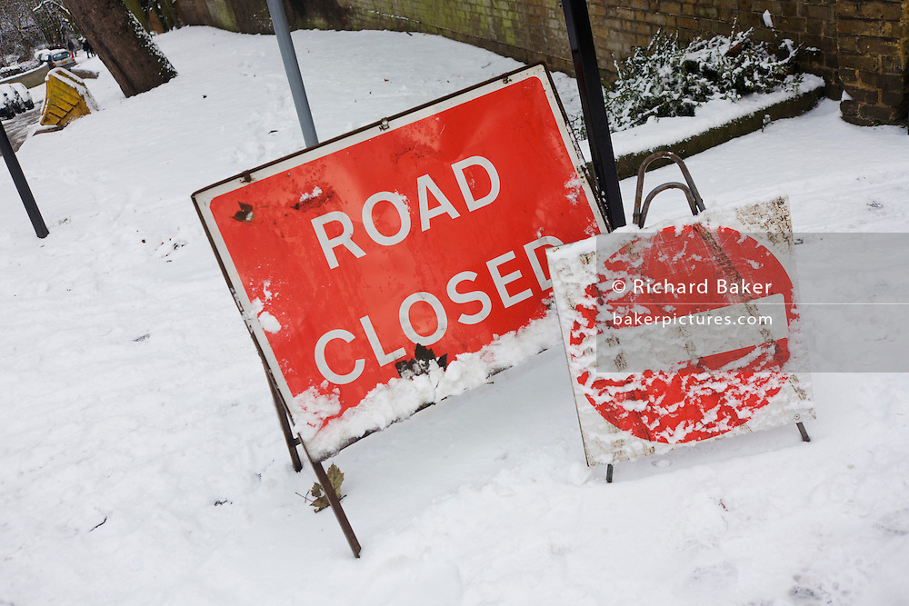 A Closed Road sign on a hill in south London during wintry snows.