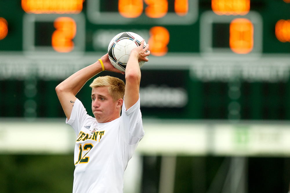 Catamounts midfielder Carter Lincoln (12) throws the ball inbounds during the men's soccer game between the Central Connecticut State University Blue Devils and the Vermont Catamounts at Virtue Field on Friday afternoon September 7, 2012 in Burlington, Vermont.