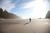 Young woman backpacking near Third Beach in Olympic National Park, WA.