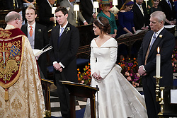 The Duke of York (right) stands next to his daughter Princess Eugenie and her groom Jack Brooksbank during their wedding ceremony at St George's Chapel in Windsor Castle.