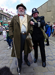 © Paul Thompson licensed to London News Pictures. 16/05/2015. Haworth, West Yorkshire, UK. A policeman and poacher during Haworth 1940s weekend, an annual event in which people dress in period costume and visit the village of Haworth to relive the 1940s.  Photo credit : Paul Thompson/LNP