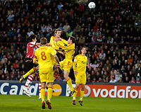 Photo: RIchard Lane.<br />PSV Eindhoven v Liverpool. UEFA Champions League, Quarter Final, 1st Leg. 03/04/2007. <br />Liverpool's Peter Crouch gets up to head the ball.