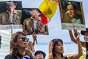 29 NOVEMBER 2013 - BANGKOK, THAILAND: Anti-government protestors carry photos of Bhumibol Adulyadej, the King of Thailand, as they march past the US Embassy in Bangkok. The protestors support the monarchy and are opposed the elected government. Several thousand Thai anti-government protestors marched on the US Embassy in Bangkok. They blew whistles and asked the US to honor their efforts to unseat the elected government of Yingluck Shinawatra. The anti-government protestors marched through several parts of Bangkok Friday paralyzing traffic but no clashes were reported, even after a group protestors tried to occupy Army headquarters.         PHOTO BY JACK KURTZ