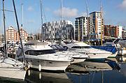 University of Suffolk waterfront buildings boats moored in marina, Ipswich Wet Dock waterside redevelopment, Ipswich, Suffolk, England, UK