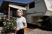 """Judy Rivers of Cullman, Alabama, stands in front of the RV that has been her home for the past two years. When the credit system declared her dead in 2010, Rivers struggled to get a job because she failed background checks and no longer had a credit history. In May, 2012, she was finally """"resurrected"""" and once again able to open a checking account."""