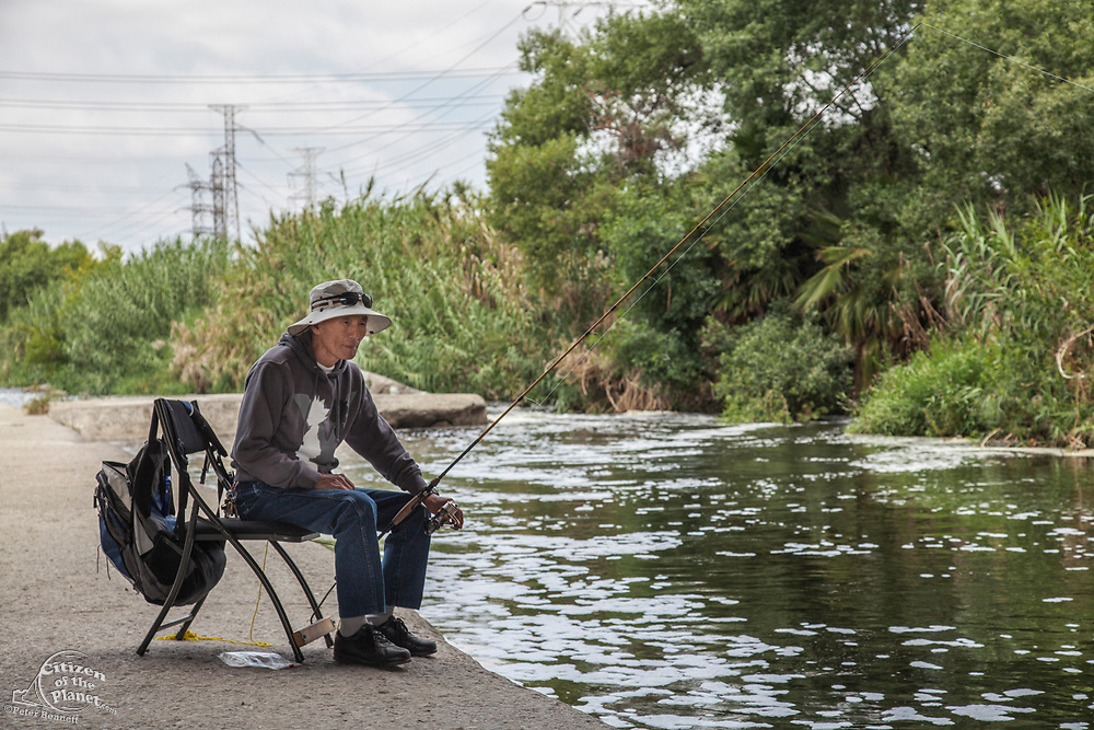 Fishing along the Los Angeles River, Elysian Valley, Los Angeles, California, USA