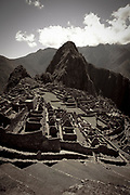 Black and white photo of the Citadel at Machu Picchu, which was an Inca city in the Andes mountains