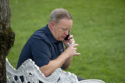July 21, 2017 - (File Photo) - White House press secretary Sean Spicer has resigned on Friday, after President Trump named a Wall Street financier as his top communications official. PICTURED: June 22, 2017 - Washington, District of Columbia, United States of America - White House Press Secretary SEAN SPICER has a private phone call as United States President Donald J. Trump and first lady Melania Trump host the annual Congressional Picnic on the South Lawn of the White House. (Credit Image: © Ron Sachs/CNP via ZUMA Wire)