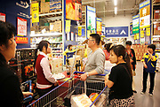 Customers shop at a Metro supermarket in Shanghai, China on 20 May 2010. Metro Group is the third largest retailing company in the world and currently has over forty store in China.