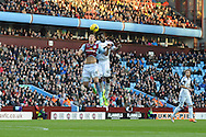 Aston Villa's Aleksander Tonev battles with Swansea City's Roland Lamah for a high ball during the Barclays Premier league, Aston Villa v Swansea city at Villa Park in Birmingham, England on Saturday 28th Dec 2013. <br /> pic by Jeff Thomas, Andrew Orchard sports photography.