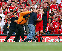 Community  Shield Millennium Stadium Cardiff  Liverpool v Chelsea (2-1)  13/08/2006<br />Mark Gonzales  (Liverpool) suffers dubious pleasure of being kissed by yob who invaded pitch<br />Photo Robin Parker Fotosports In after Crouch winner ternational