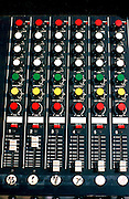 Electronic mixer board for Rock 'n' Roll band at street fair.  St Paul Minnesota USA