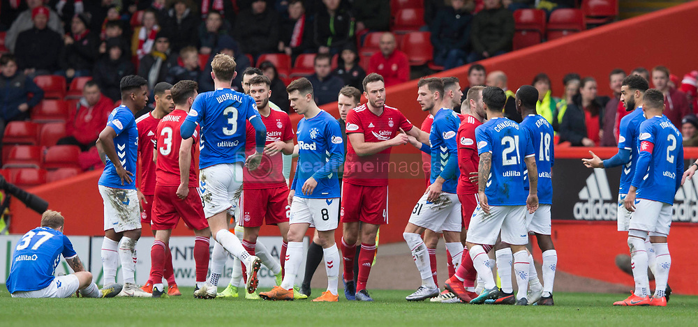 Tempers flair during the William Hill Scottish Cup quarter final match at Pittodrie Stadium, Aberdeen.