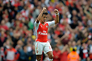 Arsenal's Alexis Sanchez celebrates scoring his teams second goal of the game. Barclays Premier league match, Arsenal v Manchester city at the Emirates Stadium in London on Saturday 13th Sept 2014.<br /> pic by John Patrick Fletcher, Andrew Orchard sports photography.