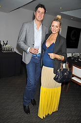 VERNON KAY and TESS DALY at a dinner hosted by Ruinart Champagne for Yasmin Mills at Nobu, Park Lane, London on rth May 2009.