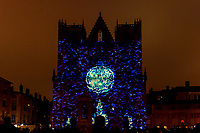 Unisson - Saint-Jean Cathedral, Lyon 5<br /> Artist: Helen Eastwood and Laurent Brun<br /> TheFestival of Lights inLyon,Franceexpresses gratitude towardMary, mother of Jesusaround December 8th of each year.<br /> This uniquely Lyonnaise tradition dictates that every house place candles along the outsides of all the windows to produce a spectacular effect throughout the streets. The festival includes other activities based on light and usually lasts four days, with the peak of activity occurring on the 8th. <br /> The two main focal points of activity are typically theBasilica of Fourvierewhich is lit up in different colours, and thePlace des Terreaux, which hosts a different light show each year.<br /> Spared from plague<br /> The origins of the festival date to 1643 when Lyon was struck byplague. <br /> On September 8,1643 the municipal councillors promised to pay tribute to Mary if the town was spared. Ever since, a solemn procession makes its way to the Basilica of Fourviere on 8 December (the feast of theImmaculate Conception) to light candles and give offerings in the name of Mary. <br /> In part, the event thus commemorates the day Lyon was consecrated to the Virgin Mary.