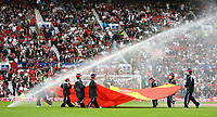 Photo: Andrew Unwin.<br />England v Macedonia. UEFA European Championships 2008 Qualifying. 07/10/2006.<br />The flag carriers get soaked by a sprinkler before the game.