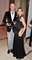 GILES DEACON and NATALIE MASSENET at the Harper's Bazaar Women of the Year Awards 2011 held at Claridge's, Brook Street, London on 7th November 2011.