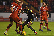 AFC Wimbledon forward Michael Folivi (41) battles with Walsall defender Cameron Norman (28) during the EFL Sky Bet League 1 match between Walsall and AFC Wimbledon at the Banks's Stadium, Walsall, England on 12 February 2019.