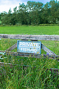 Private fishing sign on five-bar gate to a field in The Cotswolds, Oxfordshire, UK