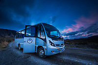 Patagonia tour bus with sunset sky above, Los Glaciares National Park, Argentina
