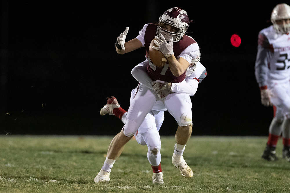 Buchanan's Gavin Fazi attempts to catch the ball as Constantine  defender makes the hit during the Constantine-Buchanan high school football game on Friday, November 13, 2020, at Memorial Field in Buchanan, Michigan.