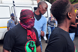 JOHANNESBURG, SOUTH AFRICA – APRIL 07: A small group of pro Zuma member from Black Land First (BLF) confront anti Zuma protestors gathered outside the Gupta's Saxonwold residence call for President Zuma to step down, the Guptas through their businesses are accused of links to goverment officials and the president, in Johannesburg, South Africa, 07 April 2017. Businesses closed and South Africans from numerous political, religious, labour and civic groups gathered at central points across the entire country protesting against President Zuma's recent government reshuffle appointing 10 new ministers and 10 new deputy ministers including the axing of the finance minister. Photo: Dino Lloyd