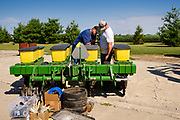 """06 AUGUST 2020 - FAIRFIELD, IOWA: JEFF KINKART, left, and BEN KINKART, both from Bloomfield, IA, look at a corn planter they planned to bid on before the auction on the Adam Farm near Fairfield. Gary Adam, 72 years old, has been farming in the Fairfield area since 1971. He decided to retire this year because he wants to travel and because it's so difficult to make money in farming this year. He said he wants to """"shed the risk and responsibility. If things were super good, like they were 2006-2012, I might stay in it, but they're not."""" An increasing number of farmers in the Midwest are retiring this year as it becomes harder to make money on crops. In addition to low prices, Iowa farmers are being hit with a drought this year, with well below average rain over most of the state. Because of the COVID-19 pandemic, the auction on Adam's farm was one of the first live in person auctions since winter. Most auctions are now done on line.    PHOTO BY JACK KURTZ"""