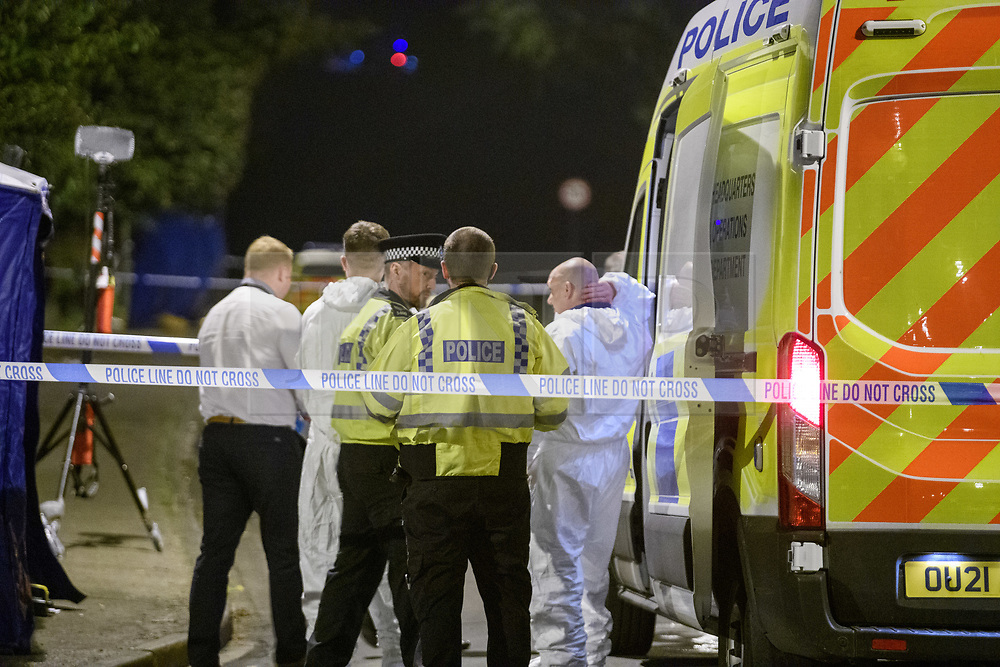 © Licensed to London News Pictures. 08/10/2021. Oxford, UK. Police officers and forensic investigators gather at the crime scene in Bayswater Road, Barton in Oxfordshire. Police were called just before 6:00pm today, Friday 08/10/2021, to reports of a man being stabbed, the victim, a man aged in his thirties, died of his injuries at the scene. Photo credit: Peter Manning/LNP