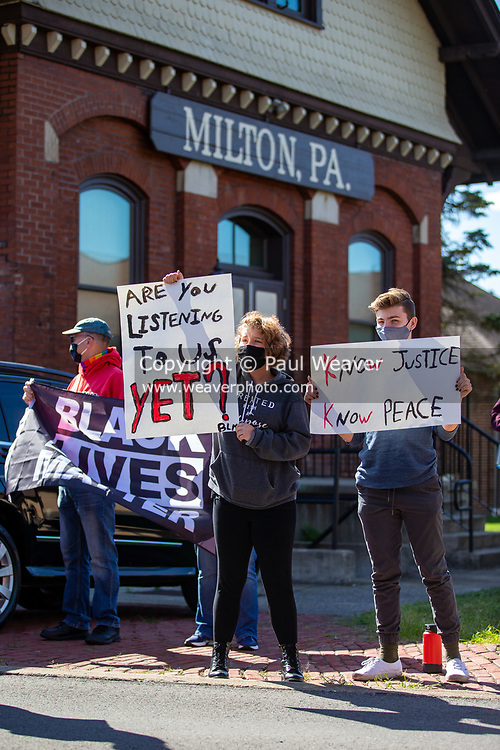 Protesters hold signs at a Black Lives Matter rally organized by the anti-racist collective 'If Not Us, Then Who?' in Milton, Pennsylvania on September 20, 2020.  (Photo by Paul Weaver)