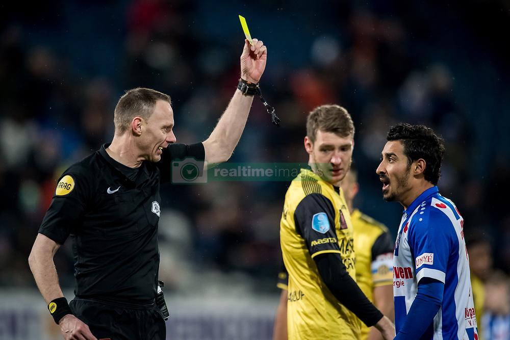 (L-R) referee Ed Janssen, Reza Ghoochannejhad of sc Heerenveen during the Dutch Eredivisie match between sc Heerenveen and Roda JC Kerkrade at Abe Lenstra Stadium on February 10, 2018 in Heerenveen, The Netherlands