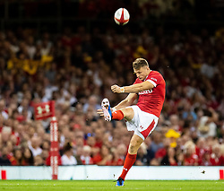 Dan Biggar of Wales kicks ahead<br /> <br /> Photographer Simon King/Replay Images<br /> <br /> Friendly - Wales v England - Saturday 17th August 2019 - Principality Stadium - Cardiff<br /> <br /> World Copyright © Replay Images . All rights reserved. info@replayimages.co.uk - http://replayimages.co.uk
