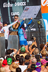 HUNTINGTON BEACH, California/USA (Saturday, August 7, 2010) - Carissa Moore displays her $50,000USD check at the awards platform while Sally Fitzgibbons of Australia pours a Red Bull energy drink on her. Carissa Moore defeated  Sally Fitzgibbons of Australia to win  the Hurley US Open of Surfing 2010. Photo: Eduardo E. Silva