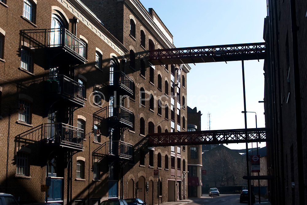 Gantry across the road at a wharf building on Wapping High Stree in the East End of London. These were once working wharves.