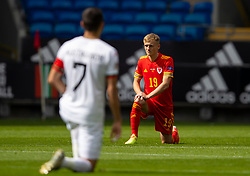 CARDIFF, WALES - Sunday, September 6, 2020: Wales' Matthew Smith kneels down (takes a knee) in support of the Black Lives Matter movement before during the UEFA Nations League Group Stage League B Group 4 match between Wales and Bulgaria at the Cardiff City Stadium. (Pic by David Rawcliffe/Propaganda)